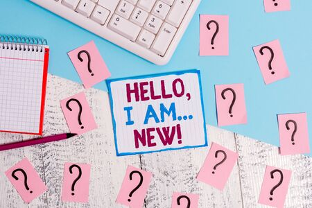 Writing note showing Hello I Am New. Business concept for used greeting or begin telephone conversation Writing tools and scribbled paper on top of the wooden table Banque d'images