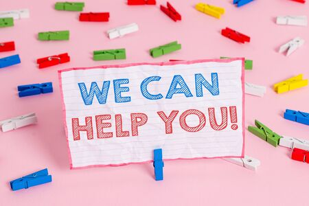 Text sign showing We Can Help You. Business photo text offering good assistance to customers or friends Colored clothespin papers empty reminder pink floor background office pin