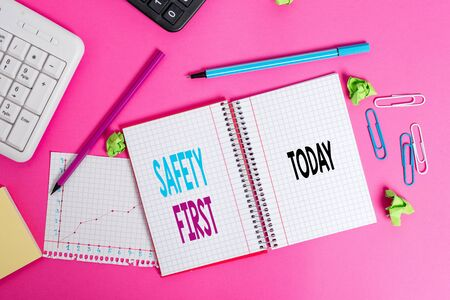 Writing note showing Safety First. Business concept for used to say that the most important thing is to be safe Writing equipments and computer stuff placed on wooden table 스톡 콘텐츠