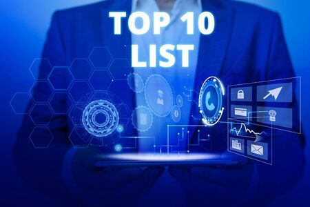 Text sign showing Top 10 List. Business photo text the ten most important or successful items in a particular list Male human wear formal work suit presenting presentation using smart device
