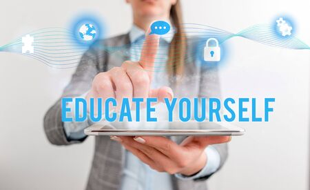 Conceptual hand writing showing Educate Yourself. Concept meaning prepare oneself or someone in a particular area or subject Female human wear formal work suit presenting smart device Stock Photo