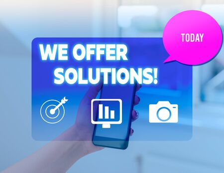 Conceptual hand writing showing We Offer Solutions. Concept meaning way to solve problem or deal with difficult situation woman smartphone speech bubble office supplies technology