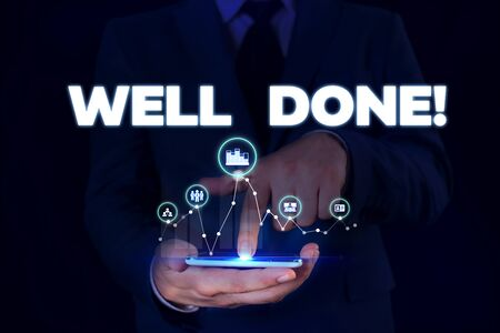 Writing note showing Well Done. Business concept for used praising demonstrating or group for something have done good way Male wear formal suit presenting presentation smart device