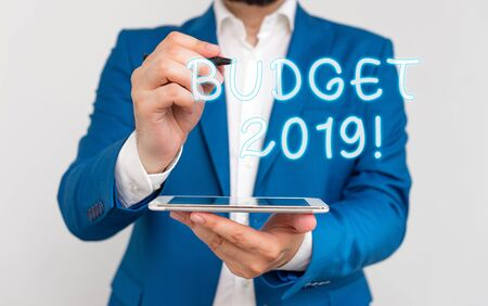 Handwriting text writing Budget 2019. Conceptual photo estimate of income and expenditure for current year Businessman with pointing finger in front of him