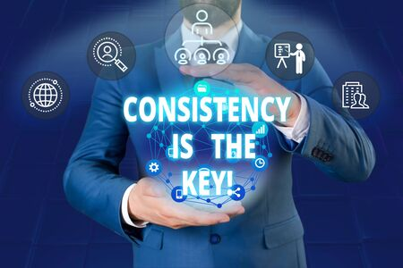 Writing note showing Consistency Is The Key. Business concept for by Breaking Bad Habits and Forming Good Ones Male human wear formal work suit presenting using smart device