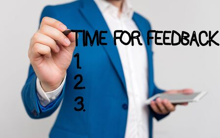 Conceptual hand writing showing Time For Feedback. Concept meaning information about reactions to a product or services Businessman blue suite and white shirt pointing with finger