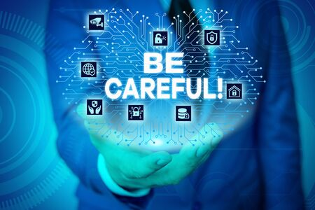 Word writing text Be Careful. Business photo showcasing making sure of avoiding potential danger mishap or harm Male human wear formal work suit presenting presentation using smart device