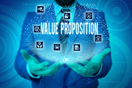 Writing note showing Value Proposition. Business concept for feature intended to make a company or product attractive Male wear formal work suit presenting presentation smart device