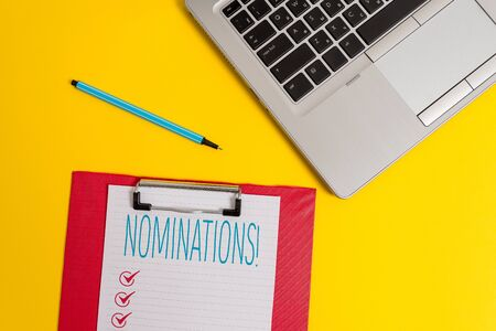 Writing note showing Nominations. Business concept for action of nominating or state being nominated for prize Trendy metallic laptop clipboard paper sheet marker colored background