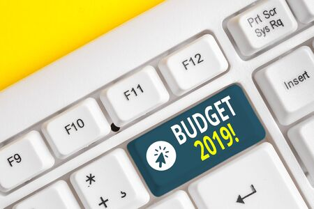 Word writing text Budget 2019. Business photo showcasing estimate of income and expenditure for current year White pc keyboard with empty note paper above white background key copy space Stok Fotoğraf - 129271617