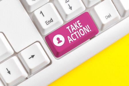 Writing note showing Take Action. Business concept for do something official or concerted to achieve aim with problem White pc keyboard with note paper above the white background Zdjęcie Seryjne