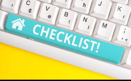 Text sign showing Checklist. Business photo showcasing list items required things be done or points considered White pc keyboard with empty note paper above white background key copy space
