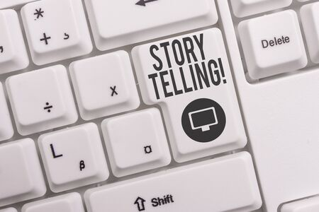 Text sign showing Story Telling. Business photo text activity writing stories for publishing them to public White pc keyboard with empty note paper above white background key copy space