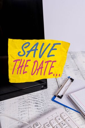 Conceptual hand writing showing Save The Date. Concept meaning Organizing events well make day special event organizers Note paper taped to black screen near keyboard stationary