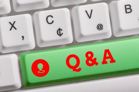 Conceptual hand writing showing Q And A. Concept meaning defined as questions being asked and answers Keyboard with note paper on white background key copy space