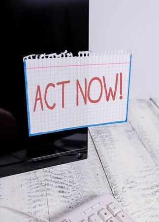 Text sign showing Act Now. Business photo text do not hesitate and start working or doing stuff right away Notation paper taped to black computer monitor screen near white keyboard