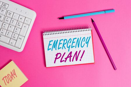 Conceptual hand writing showing Emergency Plan. Concept meaning actions developed to mitigate damage of potential events Writing equipments and computer stuff placed on wooden table Banco de Imagens