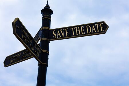 Handwriting text writing Save The Date question. Conceptual photo asking someone to remember specific day or time Road sign on the crossroads with blue cloudy sky in the background Banco de Imagens