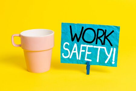 Handwriting text Work Safety. Conceptual photo policies and procedures in place to ensure health of employees Cup empty paper blue clothespin rectangle shaped reminder yellow office Stockfoto