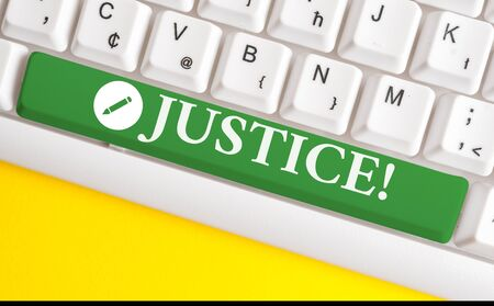 Writing note showing Justice. Business concept for impartial adjustment of conflicting claims or assignments White pc keyboard with note paper above the white background