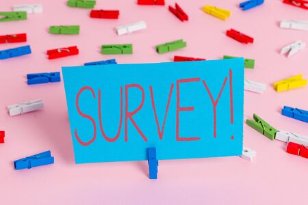 Writing note showing Survey. Business concept for research method used for collecting data from a predefined group Colored clothespin papers empty reminder pink floor office pin