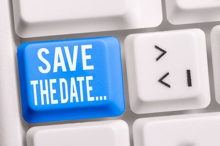 Text sign showing Save The Date. Business photo showcasing Organizing events well make day special event organizers White pc keyboard with empty note paper above white background key copy space