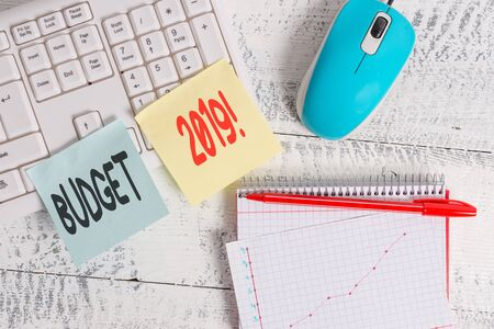 Handwriting text writing Budget 2019. Conceptual photo estimate of income and expenditure for current year Writing equipments and computer stuffs placed above classic wooden table Reklamní fotografie