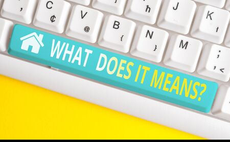 Text sign showing What Does It Means question. Business photo showcasing asking someone about meaning something said and you do not understand White pc keyboard with empty note paper above white background key copy space
