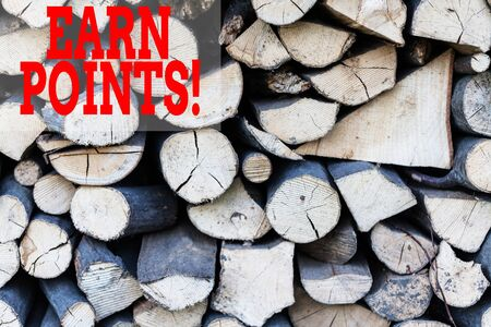 Text sign showing Earn Points. Business photo showcasing collecting scores in order qualify to win big prize Background dry chopped firewood logs stacked up in a pile winter chimney Stock Photo