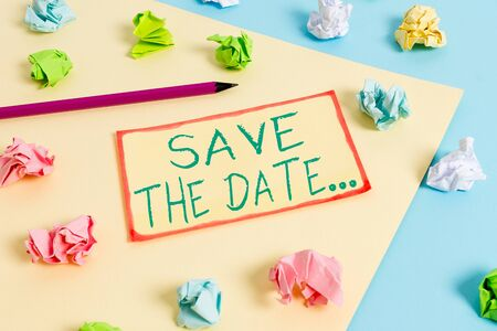 Writing note showing Save The Date. Business concept for Organizing events well make day special event organizers Colored crumpled papers empty reminder blue yellow clothespin Zdjęcie Seryjne - 129312572