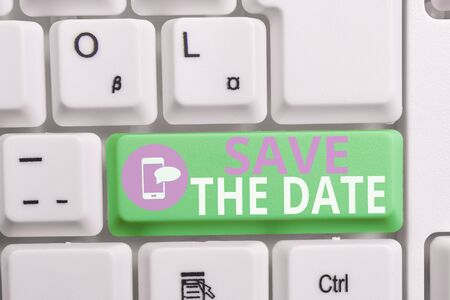 Writing note showing Save The Date question. Business concept for asking someone to remember specific day or time Keyboard with note paper on white background key copy space Zdjęcie Seryjne - 129317326