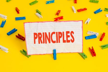 Conceptual hand writing showing Principles. Concept meaning fundamental truth that serves as the base for a system of belief Colored clothespin papers empty reminder yellow floor office