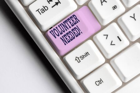 Word writing text Volunteer Needed. Business photo showcasing need work for organization without being paid White pc keyboard with empty note paper above white background key copy space Stok Fotoğraf
