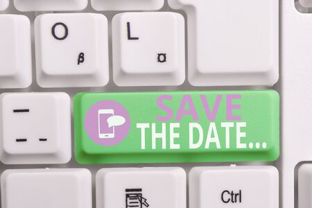 Writing note showing Save The Date. Business concept for Organizing events well make day special event organizers Keyboard with note paper on white background key copy space Zdjęcie Seryjne - 129318405