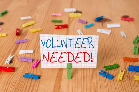 Text sign showing Volunteer Needed. Business photo text need work for organization without being paid Colored clothespin papers empty reminder wooden floor background office