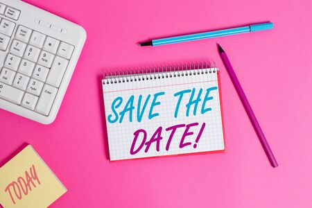 Conceptual hand writing showing Save The Date. Concept meaning Organizing events well make day special event organizers Writing equipments and computer stuff placed on wooden table Zdjęcie Seryjne - 129318896