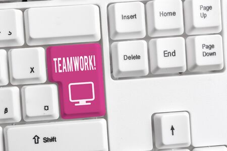 Conceptual hand writing showing Teamwork. Concept meaning combined action of group especially when effective and efficient White pc keyboard with note paper above the white background