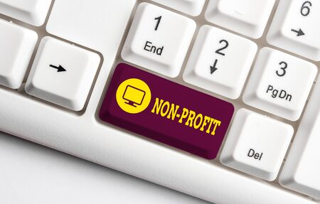 Handwriting text writing Non Profit. Conceptual photo type of organization that does not earn profits for its owners White pc keyboard with empty note paper above white background key copy space