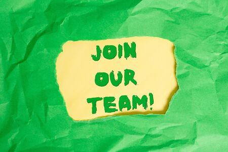 Writing note showing Join Our Team. Business concept for inviting someone into your local group or company Green crumpled colored paper sheet torn colorful background
