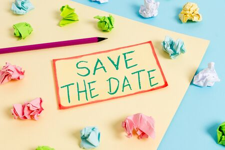 Writing note showing Save The Date question. Business concept for asking someone to remember specific day or time Colored crumpled papers empty reminder blue yellow clothespin