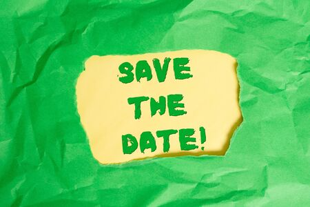 Writing note showing Save The Date. Business concept for Organizing events well make day special event organizers Green crumpled colored paper sheet torn colorful background Stockfoto