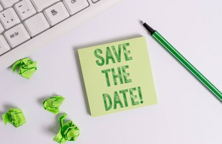 Conceptual hand writing showing Save The Date. Concept meaning Organizing events well make day special event organizers Green note paper with pencil on white background and pc keyboard
