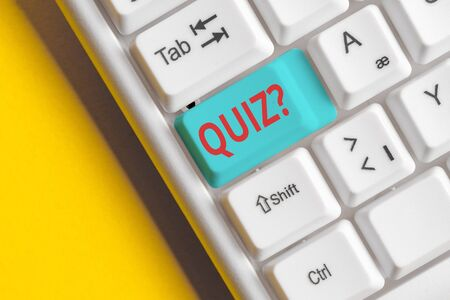 Handwriting text Quiz Question. Conceptual photo test of knowledge as competition between individuals or teams White pc keyboard with empty note paper above white background key copy space Stock fotó