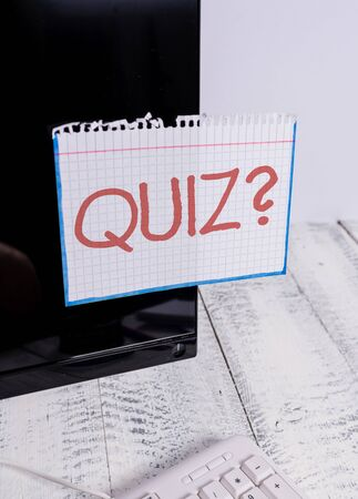 Text sign showing Quiz Question. Business photo text test of knowledge as competition between individuals or teams Notation paper taped to black computer monitor screen near white keyboard Stock fotó