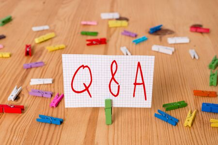 Text sign showing Q And A. Business photo text defined as questions being asked and answers Colored clothespin papers empty reminder wooden floor background office Stock fotó - 129363161