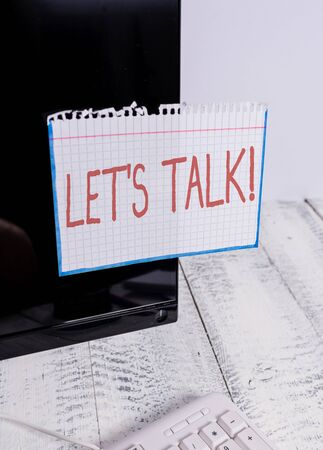 Text sign showing Let S Talk. Business photo text they are suggesting beginning conversation on specific topic Notation paper taped to black computer monitor screen near white keyboard