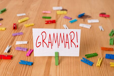 Text sign showing Grammar. Business photo text whole system structure language syntax and morphology Colored clothespin papers empty reminder wooden floor background office
