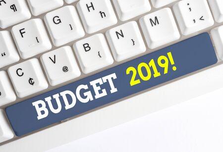 Conceptual hand writing showing Budget 2019. Concept meaning estimate of income and expenditure for current year White pc keyboard with note paper above the white background