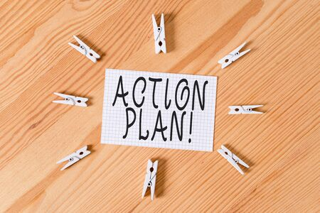Conceptual hand writing showing Action Plan. Concept meaning proposed strategy or course of actions for certain time Colored crumpled papers wooden floor background clothespin Stock fotó