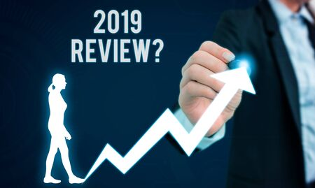 Word writing text 2019 Review Question. Business photo showcasing remembering past year events main actions or good shows Female human wear formal work suit presenting presentation use smart device 版權商用圖片